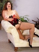 Sexy bbw hottie in black stockings fucking her chubby pussy with a red toy