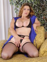 Small tits brunette Shellie puts on sexy black stockings on her couch