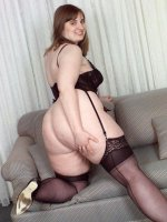 Busty plumper in pantyhose Krystal gets off by showing her huge tits