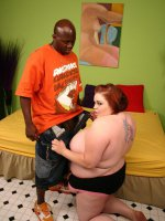 Lusty large babe Candace Cane lets a black hunk suck on her huge tits and fuck her juicy cunt