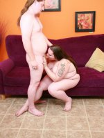 Naughty BBW Menoly welcomes her guest into her living room and offers her wet cushioned pussy