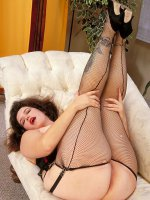 Fishnet stockings look amazing on this busty bbw hottie as she makes you hard