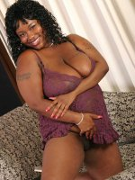 Busty ebony babe Taylor Juggs shows her melons in sexy lingerie