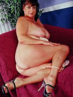 Gorgeous milf BBW Terra is posing and seducing in sexy high heels
