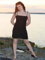 Hot fatty lifts the hem of her little black dress
