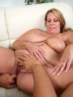 Enormous blonde BBW Leighann playing with her huge boobs while a guy ate out her fat muff live