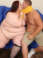 Flabby huge bitch spreading her stockinged legs for a hard fuck