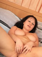 Chubby brunette stretches pussy and plays with vibrator