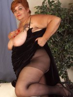 Super sized tatooed BBW Misst is posing her huge melons in stockings
