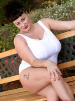 BBW hottie Betty Boob outdoors on a bench getting naked