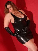 Busty BBW Tiffany Blake in sexy latex skirt showing off her thick legs