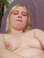 Fat slut plays with a giant double-headed dildo