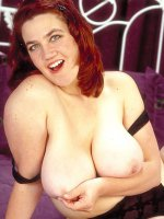 Beautiful redhead Corrine showed her enormous big tits and chubby pussy