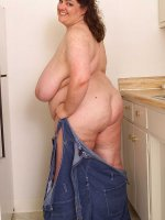 BBW Sincerely Yours is having fun teasing in the kitchen shows huge tits