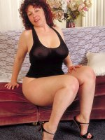 Thick loveable Yvette is teasing and spreading her big chubby legs for you