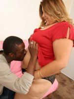 Flabby blonde babe sucking a huge black cock