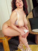 Chubby milf spreading her nice pussy and big tits