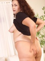 Fatty latina babe Janelle shows her huge melons and fat ass in pantyhose