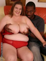 Big ass bbw Charlly showing off her plump tits while humping on top of a black cock