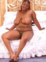 Ebony BBW Leticia naughty posing showing great big boobies and pussy