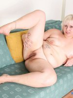 Blond plumper plays with her jugs and hairy pussy