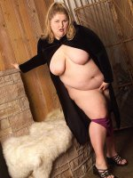 Alluring BBW blonde babe Yummy showing her fatty boobs and thick legs