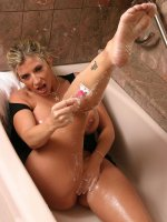 Chubby goddess Sara Jay in the bath tub spraying that nice shaved pussy