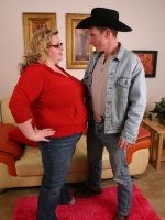 Naughty Holli welcomes a cowboy into the big city by sitting on top of his lap to ride his dick