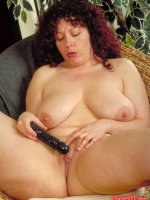 Chubby women with big tits using a toy on her shaved pussy