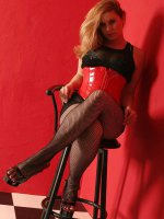 BBW Tiffany Blake wearing black stockings seducing on a bar chair