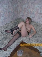 Young BBW getting off her black stockings and tango pants