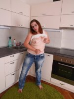 Chubby young BBW in glasses gets all naked in kitchen