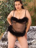 Stunning mature latina Juanita spreads her clean shaved pussy while on couch