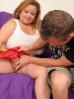 Lusty plumper Vivian squeezes a plump and stiff dick between her large jugs and gets her face jizzed