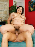 Fatty drains her lover's balls with mouth and tits
