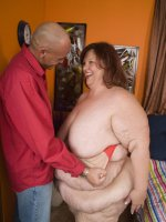 Hot BBW Sweet Cheeks bares it all to expose her mind blowing set of fat knockers and huge ass