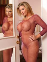 Big boobie BBW Sara Jay showing her huge tits in red fishnet