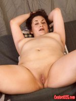 Naughty chubby lady on her back spreading her shaved pussy