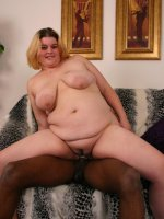 Blonde BBW Drew sizing up a huge black dick with her mouth and taking it deep in her cunt live