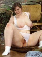BBW hottie Krystal gets naked on a chair and plays with that fat pussy