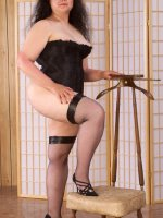 Chubby cutie Kathy in black stockings showing her perky tits