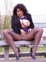 BBW hottie Ashley outdoors in sexy black pantyhose playing with her big tits