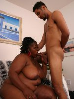 Big black bbw Subrina sucking off a meaty stick and gets cock pounding in her pussy